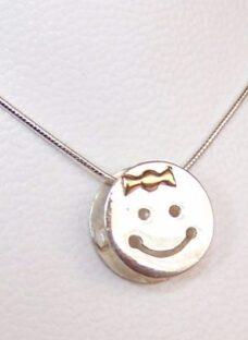 http://articulo.mercadolibre.com.ar/MLA-604508660-dije-carita-nene-nena-plata-925-combinado-oro-12mm-_JM