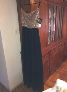 http://articulo.mercadolibre.com.ar/MLA-634816100-vestido-de-fiesta-dorado-y-negro-largo-_JM